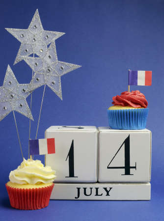 fourteenth: France National holiday calendar, 14 July, Fourteenth of July, Bastille Day, with flags , cakes and stars decorations. Vertical.