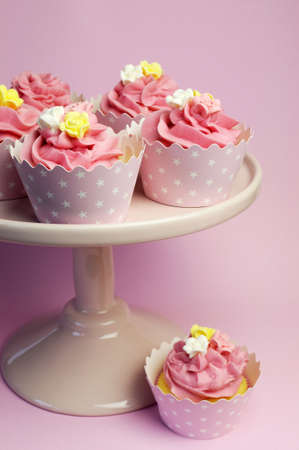 topper: Beautiful pink cupcakes in star holders on pink cake stand for birthday, bridal, wedding, bachelorette or female special occasion event.