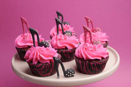 topper: Female high heel shoes decorated pink and black red velvet cupcakes with high heel shoes for teenage, female birthday, or wedding bridal shower