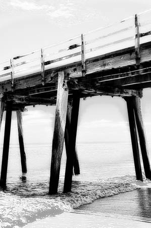 gr: High Dynamic Range HDR photography of black & white image of the Grange Jetty pier in South Australia. Stock Photo