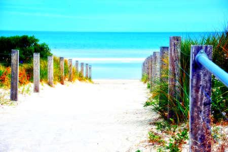 high dynamic range: High Dynamic Range HDR photography of a sandy path leading down to a crystal blue sea ocean. Taken at Henley Beach, South Australia. Stock Photo