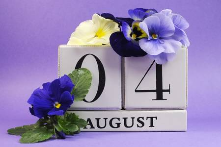 violas: Save the Date white block calendar for August 4, International Friendship Day, decorated with blue and white pansy violas on blue purple background