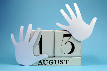 left hand: Save the Date calendar for International Left Handers Day on August 13, with with block calendar and left hand cut-outs