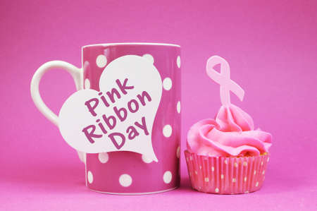 Pink cupcakes with Pink Ribbon symbol for International Breast Cancer Awareness charity month of October, with Pink Ribbon Day message on polka dot cup. Stock Photo - 21194656