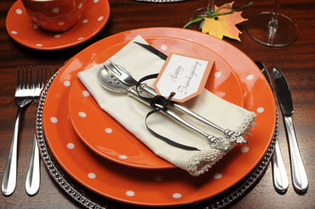 Beautiful Autumn Fall theme Thanksgiving dinner table place setting with Happy Thanksgiving tag attached to silverware  photo