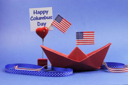 USA holiday, Happy Columbus Day, for the second Monday in October celebration Save the Date calendar with a red paper boat and stars and strips flags and ribbons decorations  photo