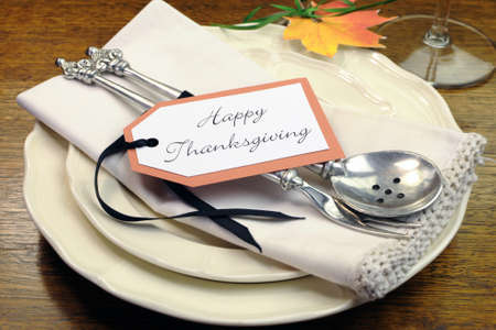 dinnerware: Happy Thanksgiving individual dinner table place setting with best dinnerware and silverware and greeting tag