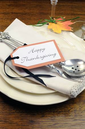 Happy Thanksgiving individual dinner table place setting with best dinnerware and silverware and greeting tag  Vertical,