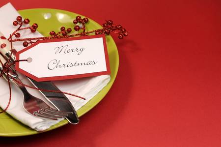 Modern trend lime green and red Merry Christmas table place setting, with copy space for your text here. photo
