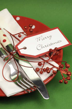 Traditional red and green Merry Christmas dinner or lunch table place setting. Close up - vertical. Stock Photo