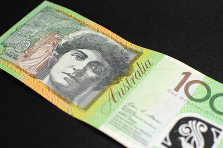 five dollars: Australian green and gold  100 hundred dollar note, against a black background  Stock Photo