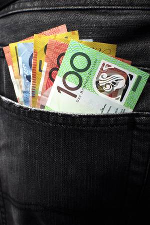 back pocket: Australian money including 100, 50, 5, 10 and 20 dollar notes, in back pocket of a man