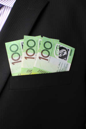 australian dollars: Three hundred dollar notes in business mans black suit top front pocket. V Stock Photo