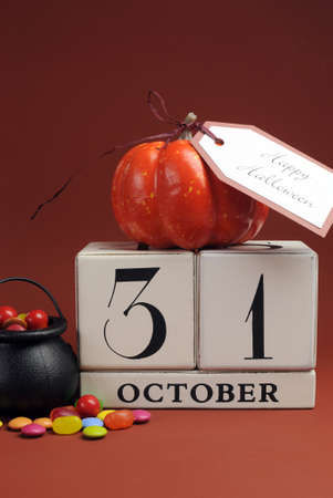 31: Happy Halloween save the date calendar for October 31 with pumpkin and cauldron candy - vertical.