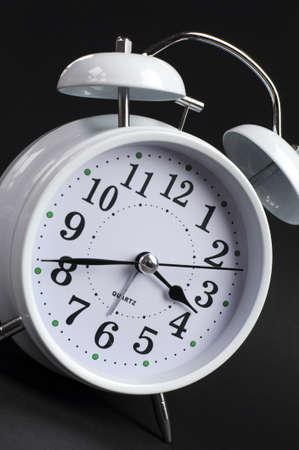 Beautiful white old fashion alarm clock against black background  Close up angle Stock Photo - 22002111