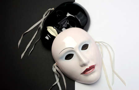 Black and white theme ceramic masks for actor, performance, emotions and theatre concept. photo