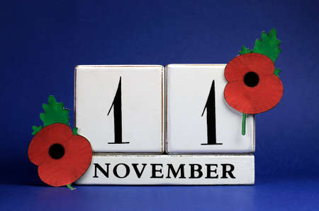 remembrance day: November 11 with red Flanders Poppies against a dark blue background.