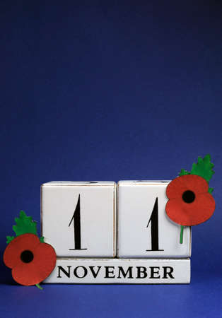 armistice: November 11 with red Flanders Poppies against a dark blue background.