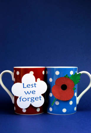 remembrance day: coffee tea cup mugs with Lest We Forget message and Flanders red poppy icon
