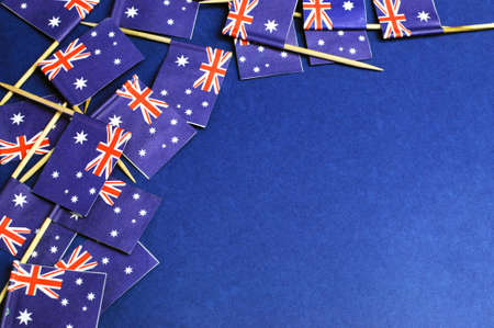 australia flag: Australian flags background, with red white and blue Southern Cross flags against a dark blue background, with copy space for your text here. Stock Photo