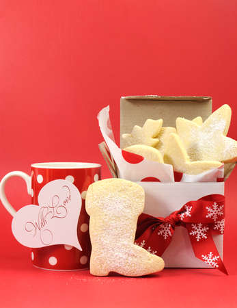 Homemade shortbread biscuit cookies with cup of tea or coffee with love heart gift tag Christmas gift for Santa. photo