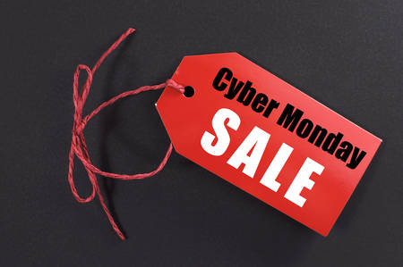 long weekend: Cyber Monday online Christmas shopping sale concept with text on red ticket against a black background