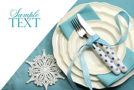 Beautiful aqua blue festive Christmas dining table place setting with Happy Holiday ornaments and decorations with copy space for your text here. Imagens