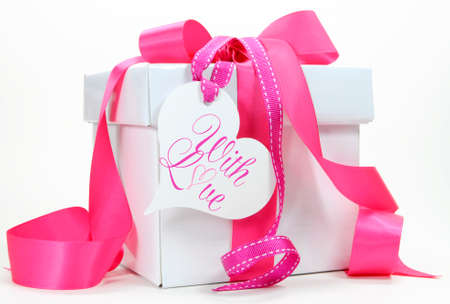 Beautiful pink and white gift box present for Christmas, Valentine, birthday, wedding or mothers day special holiday and occasions.