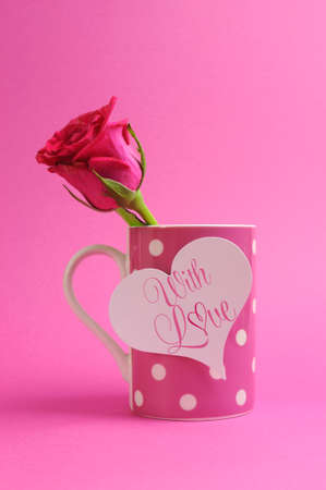 With all my love message greeting on pink polka dot coffee mug with pink rose bud for Valentines Day, Mothers Day, Easter, Wedding, birthday or special occasion gift. photo