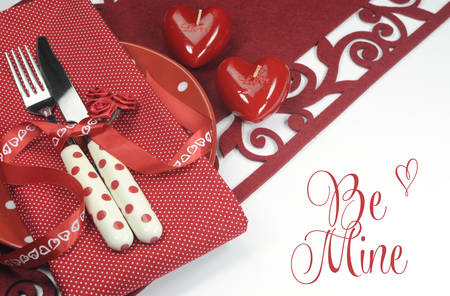 Red Valentine, wedding or love theme dining table place setting with Be Mine greeting or copy space for your text here  photo