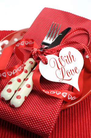 Vertical close up of red theme Valentine, wedding or love theme dining table setting  photo