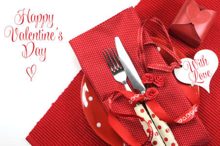 Happy Valentines Day red theme dining table place setting with greeting message or copy space for your text here  photo
