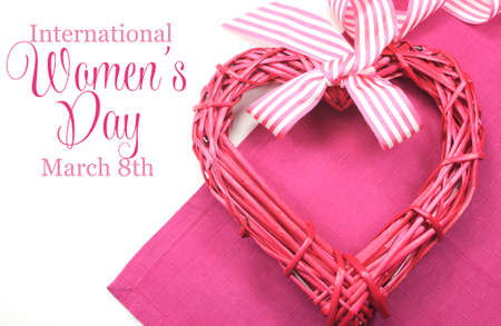 new years day: Happy International Womens Day, March 8, celebration greeting message with pink rattan cane heart and stripe ribbon
