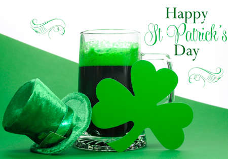 Happy St Patricks Day green beer in large glass stein with shamrocks and leprechaun hat and sample text greeting
