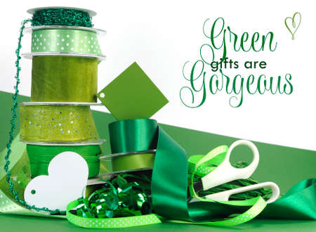 Bright colorful green theme gift wrapping with ribbons, bows, gift tags, scissors, and wrapping paper, with sample text or copy space for your text here. photo