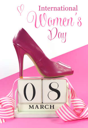 Beautiful female icon pink high heel shoe with vintage shabby chic wood calendar for March 8, International Womens Day on pink and white background.