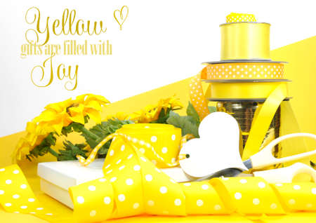 Yellow theme gift wrapping with sample text or copy space for Easter, birthday, wedding, baby or bridal shower present  photo