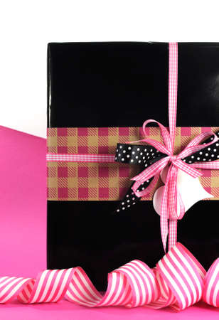Modern theme Valentine or birthday gift box with hot candy pink and black polka dot theme wrapping with copy space for your text here  photo