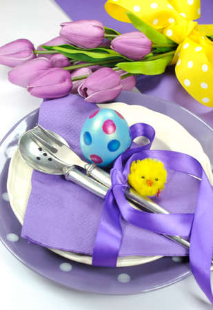 Happy Easter yellow and purple mauve lilac theme easter table place setting  photo