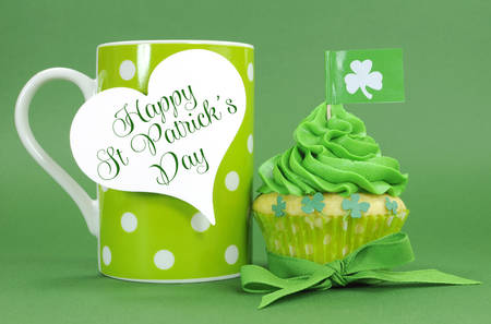 Happy St Patricks Day green cupcakes with shamrock flags and green polka dot coffee cup with heart shaped gift tag.
