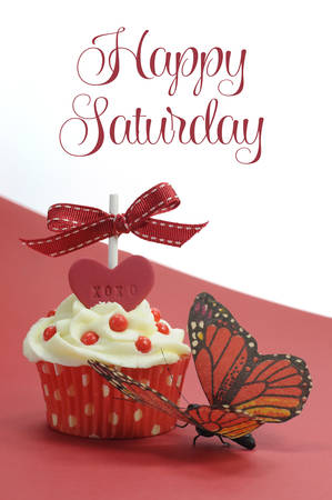 Red theme cupcake with butterfly on red and white with Happy Saturday sample text or copy space for your text here. photo