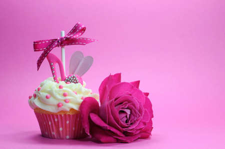 Fuchsia pink theme cupcake with shoe and heart decoration and beautiful rose, for International Womens Day, Mothers Day, female birthday or bridal shower.