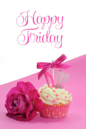 Fuchsia pink theme cupcake with shoe and heart decoration and beautiful rose, with Happy Friday sample text or copy space for text here. photo