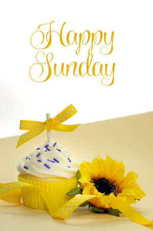 Yellow theme cupcake and sunflower with Happy Sunday sample text or copy space for text here. photo