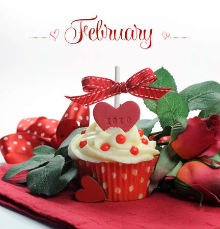 st  valentine       day: Beautiful red heart Valentine theme cupcake with roses and decorations for the month of February with sample text or copy space for your text here  Stock Photo