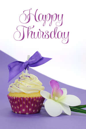 Purple theme cupcake with orchid flower with Happy Thursday sample text or copy space for your text here  photo
