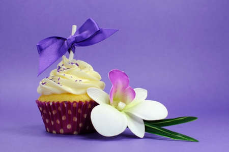 Purple theme cupcake with orchid flower for wedding, bridal or baby shower, mothers day, or female birthday  photo