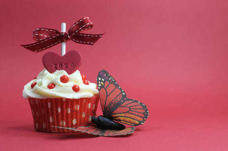 Red theme cupcake with love heart and butterfly on red for Valentines Day, Mothers Day, bridal shower, wedding, or birthday party  photo