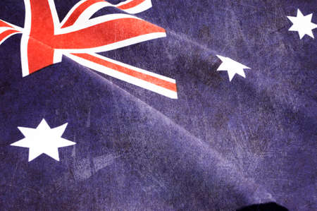 Grunge distressed aged old Australian flag for Anzac Day, 70th anniversary WWII, or 100th anniversary start of WWI events  photo