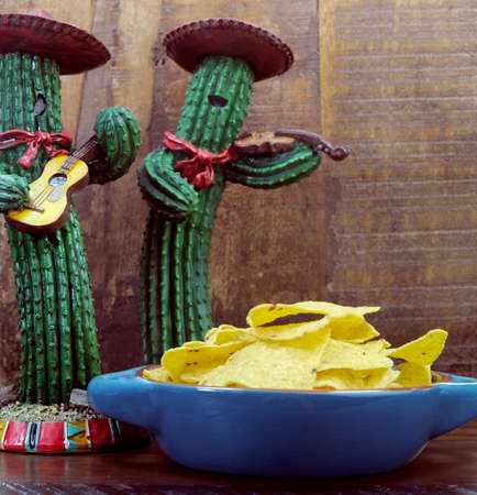 fun Mexican cactus and corn chips against retro dark wood background